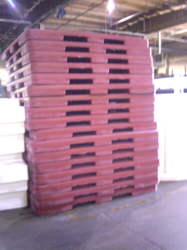 Stack of Plastic Pallets, Plastic Pallets being manufactured